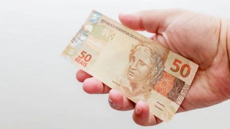 Nota de 50 reais: usando dinheiro em Salvador